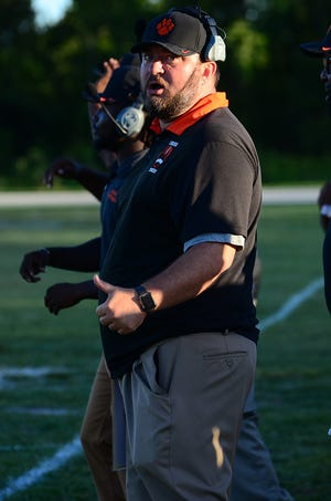 New Cocoa Tiger head coach Ryan Schneider looks over the field Friday night in Cocoa's first preseason game of the year.