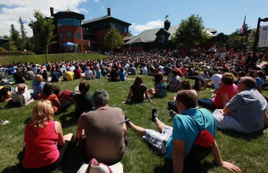 Hundreds of parents and students listen to Dave Finney, President of Champlain College, on Aiken Lawn during the new student orientation at Champlain College in Burlington, VT, on Friday, August, 2011.