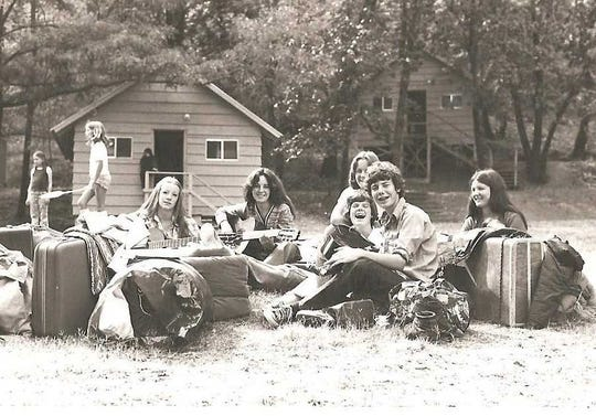 Camp counselors, including John Cooper, wait for their bus home from N.E.E.D. Camp in the mid-'70s.