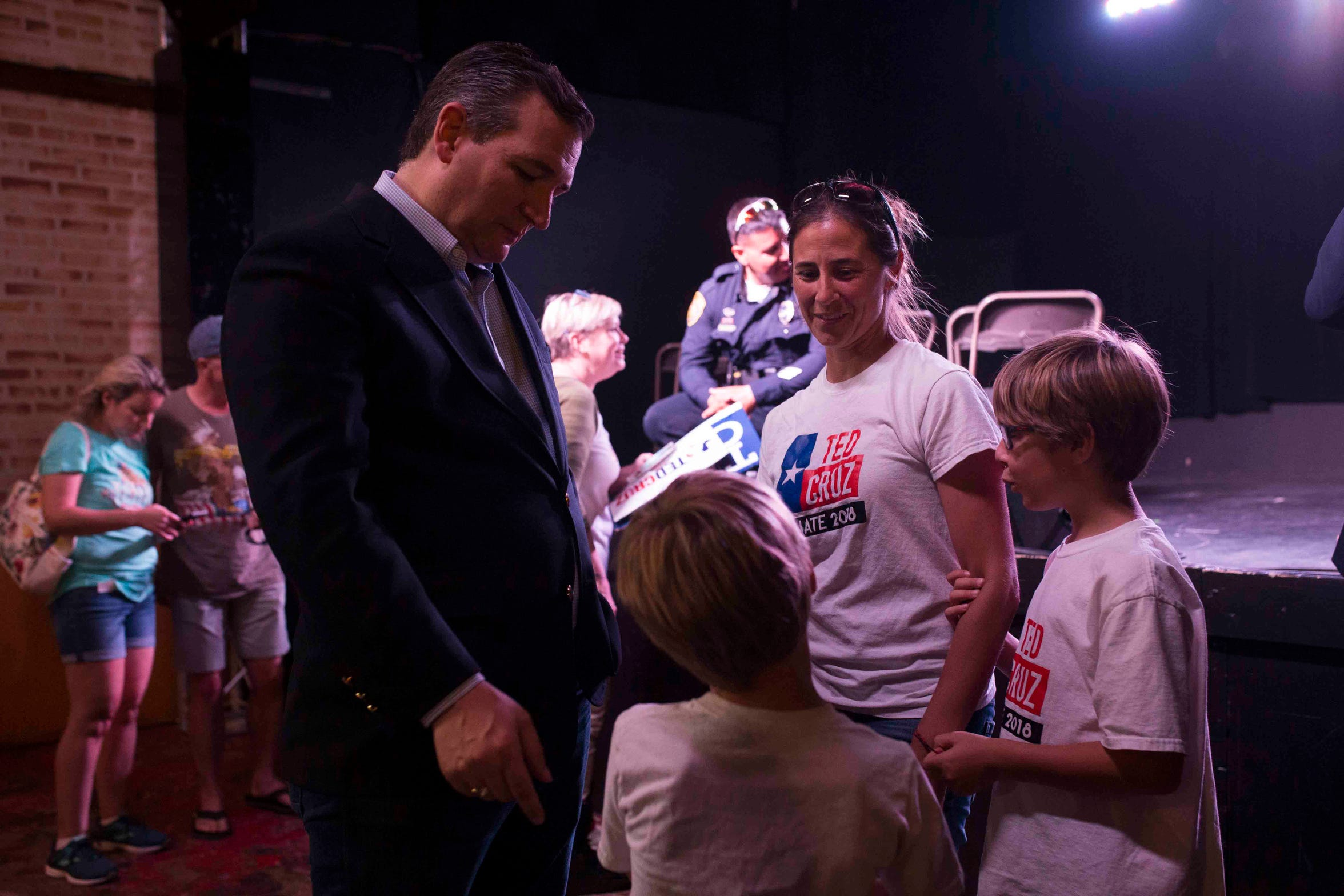 Jessica Tucker and her sons Gaven Tucker, 7 (left), and Walker Tucker, 9, speak with U.S. Sen. Ted Cruz following a  campaign event on Saturday, August 16, 2018, at House of Rock in Corpus Christi.