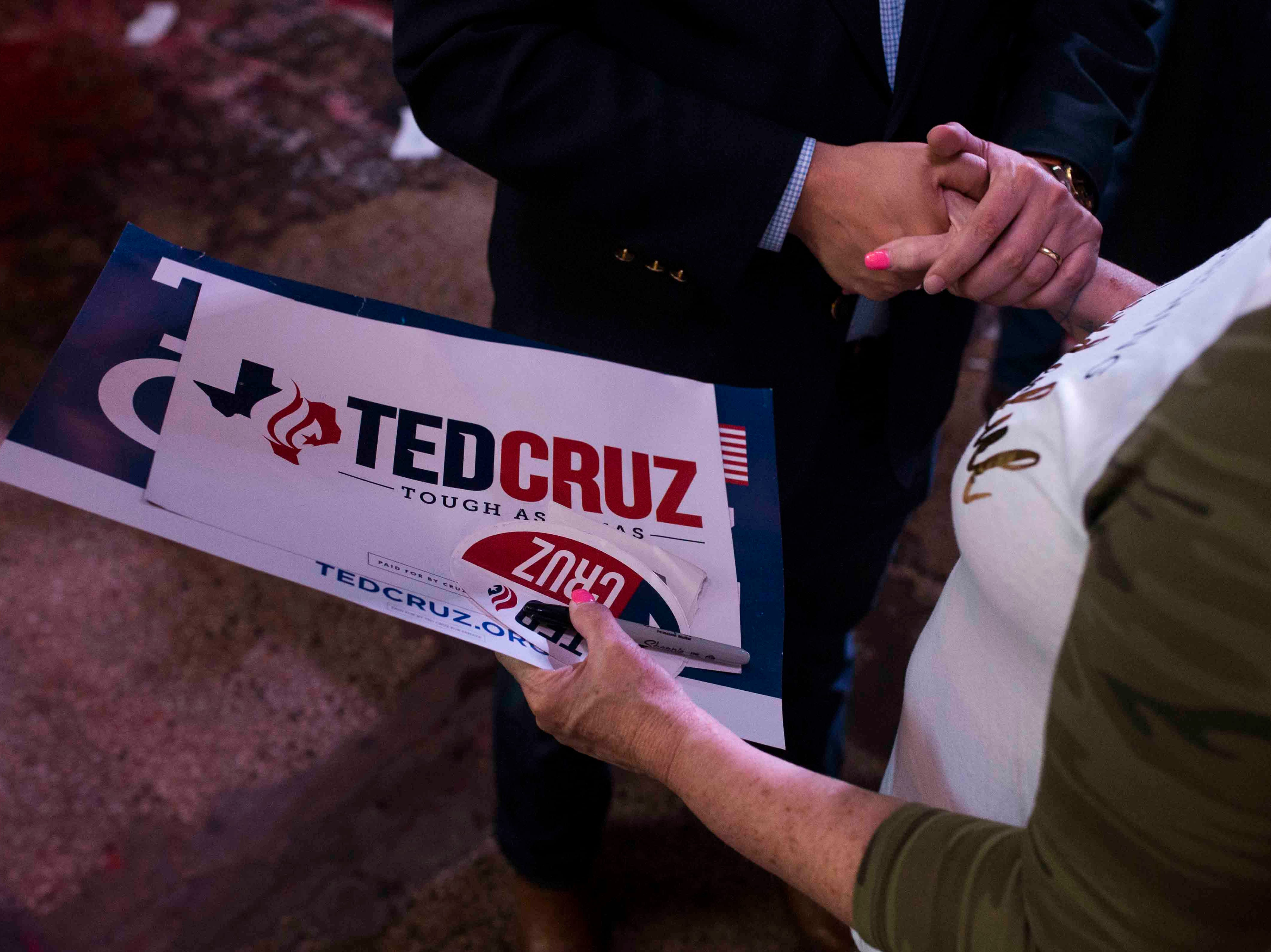 U.S. Sen. Ted Cruz embraces a supporter during a campaign event on Saturday, August 16, 2018, at House of Rock in Corpus Christi.