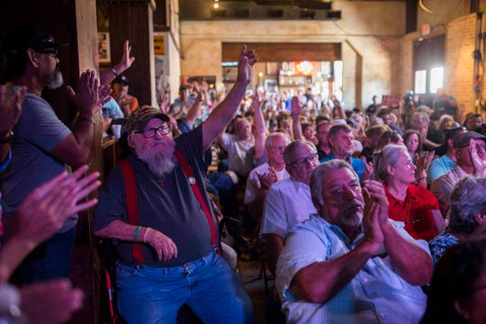 James T.C. Chadden holds up his hand with fellow veterans when they are recognized during a Ted Cruz campaign event on Saturday, August 16, 2018, at House of Rock in Corpus Christi.