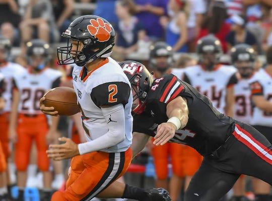 Lawrenceburg freshman quarterback Garrett Yoon (2) runs the ball against East Central in the Skyline Chili Crosstown Showdown, St. Leon, IN, Aug. 17, 2018