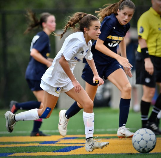 Mariemont freshman, Maddy Murphy, leads a Warriors attack in the second half against Seven Hills Friday, August 17th at Seven Hills High School