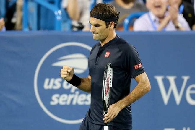 Roger Federer, of Switzerland, reacts after winning a tie-breaker in the second set against to Stan Wawrinka, of Switzerland, during a quarterfinal match of the Western & Southern Open tennis tournament, Friday, Aug. 17, 2018, at the Lindner Family Tennis Center in Mason, Ohio.