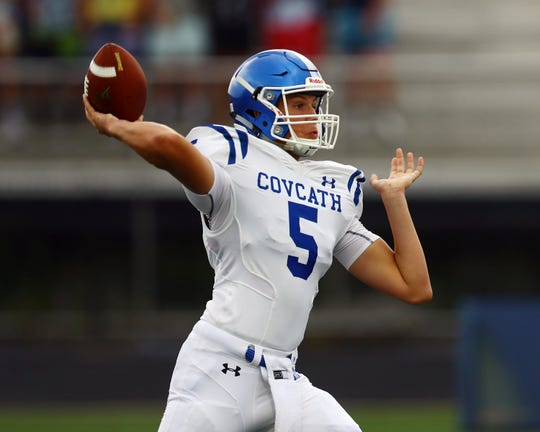 Covington Catholic quarterback Caleb Jacob attempts a pass against the Ryle Raiders at the Skyline Chili Crosstown Showdown at Ryle High School, Aug. 17.