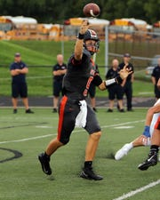 Ryle quarterback Jake Smith attempts a pass against Covington Catholic at the Skyline Chili Crosstown Showdown at Ryle High School. Covington Catholic defeated Ryle 40-7.