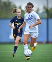 Mariemont's Alivia Naticchioni gets by the Seven Hills defense Friday, August 17th at Seven Hills High School