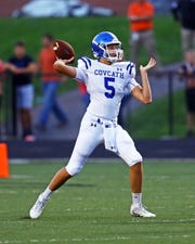Covington Catholic quarterback Caleb Jacob, shown in a game against Ryle last year, had a three-touchdown passing game and rushed for one touchdown against Beechwood Sept. 20.