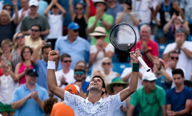 Novak Djokovic celebrates after defeating Marin Cilic 6-4, 3-6, 6-3, during the Western & Southern Open semi-final match at the Lindner Family Tennis Center in Mason, Ohio, on Saturday, Aug. 18, 2018.