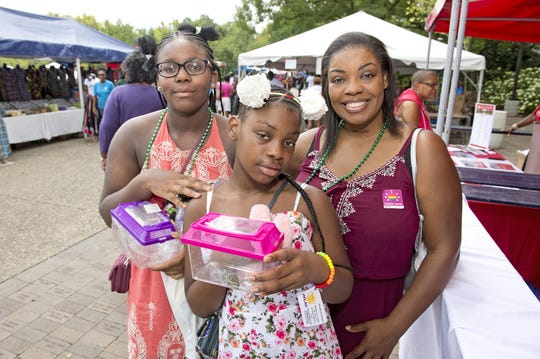 The Midwest Black Family Reunion took place at Sawyer Point Saturday, August 18, 2018. Melani and Sabrina Kelly and Melody Calhoun of Pleasant Ridge.