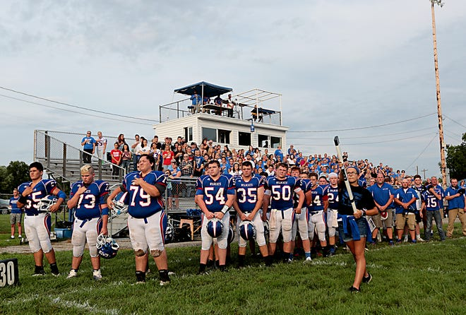 The National Anthem is played before the jamboree game against St. Bernard-Elmwood Place in Williamsburg Friday, August 17, 2018. The game was played in honor of late coach Ken Osborne.