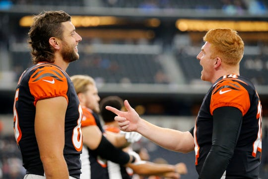 Cincinnati Bengals tight end Tyler Eifert (85) and quarterback Andy Dalton (14) laugh during pregame warmups before the NFL Preseason Week Two game between the Dallas Cowboys and the Cincinnati Bengals at AT&T Stadium in Arlington, Texas, on Saturday, Aug. 18, 2018.