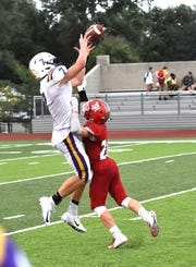 Reid Jolly (7) pulls down a catch for Campbell County as the Camels top Dixie Heights to open the 2018 KHSAA football season in Northern Kentucky, August 17, 2018.