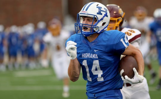 Highlands wide receiver Hunter Ahfeld (14) runs for a touchdown during the Bluebirds' football game against Cooper, Friday, Aug. 17, 2018.