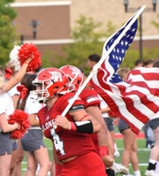 CJ Bensman leads the Colonels of Dixie Heights on the field for their home opener against Campbell County, August 18, 2018.
