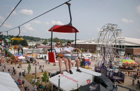 Fairgoers pass over the Iowa State Fair on Saturday, Aug. 18, 2018, at the in Des Moines.