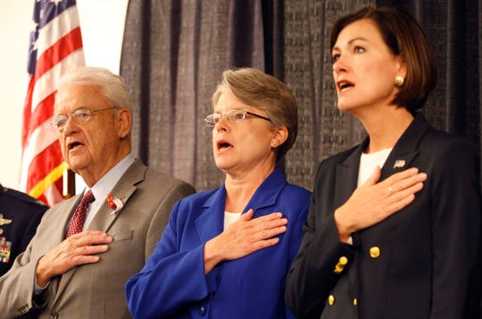 Congressman Leonard Boswell stands with former State Rep. Jodi Tymeson and Lt. Gov. Kim Reynolds as they recited the Pledge of Allegiance during a Memorial Day service insdie a room in the Iowa Events Center, Monday, May 30, 2011.