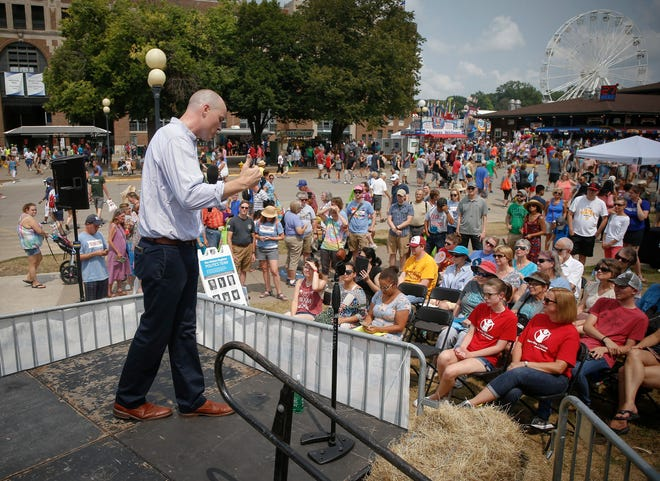 J.D. Scholten, democratic candidate for Iowa's Fourth Congressional District, speaks to supporters at the Political Soapbox on Saturday, Aug. 18, 2018, at the Iowa State Fair in Des Moines.