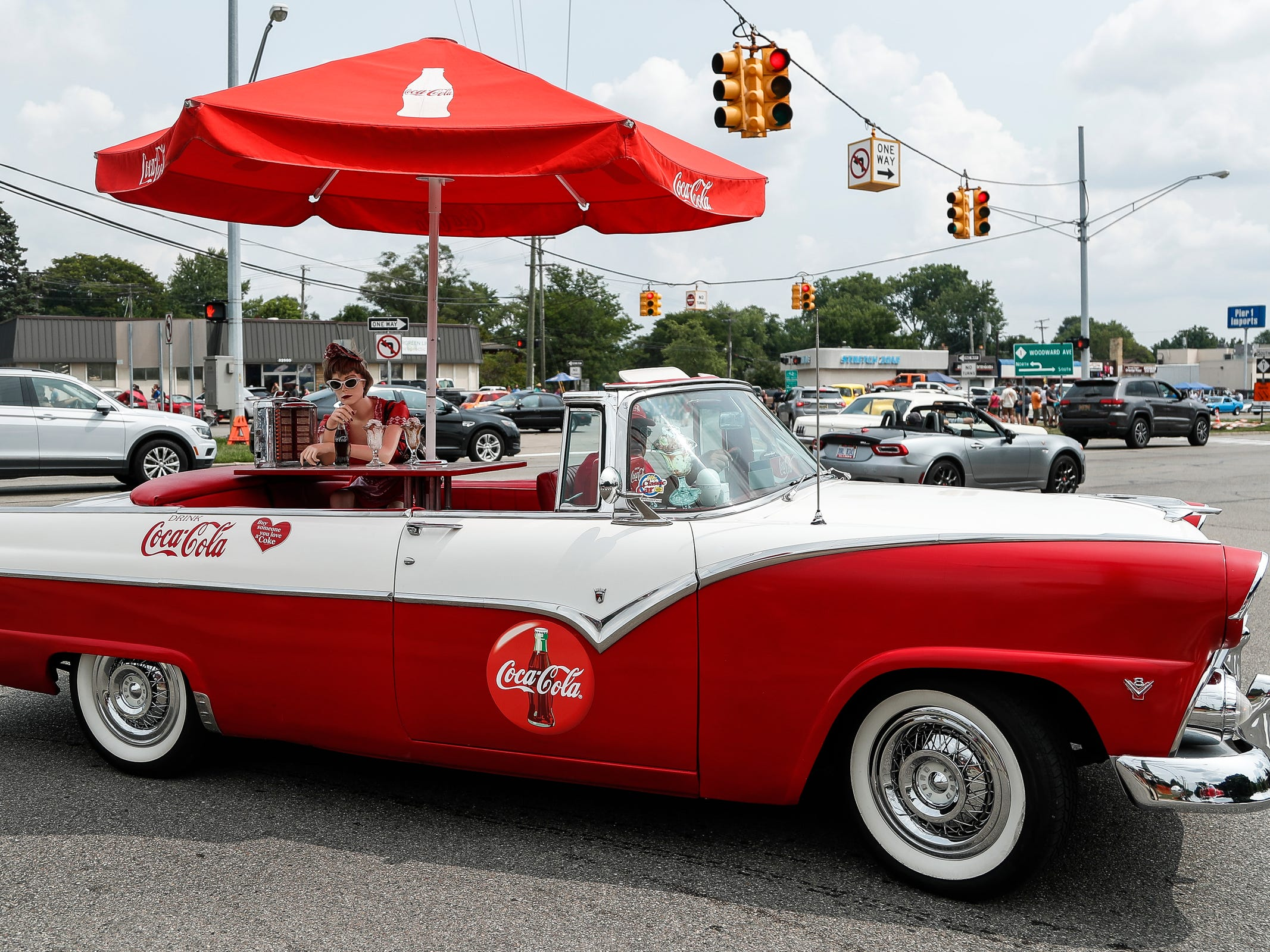 Bob Haas of South Lyon cruises in his Coca-Cola themed 1955 Ford along Woodward Avenue in Royal Oak during Woodward Dream Cruise, Saturday, August 18, 2018.