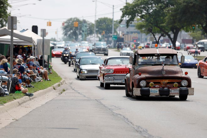 Classic and modern cars cruise down Woodward Avenue near 13 Mile Road during the Woodward Dream Cruise, Saturday, Aug. 18, 2018.