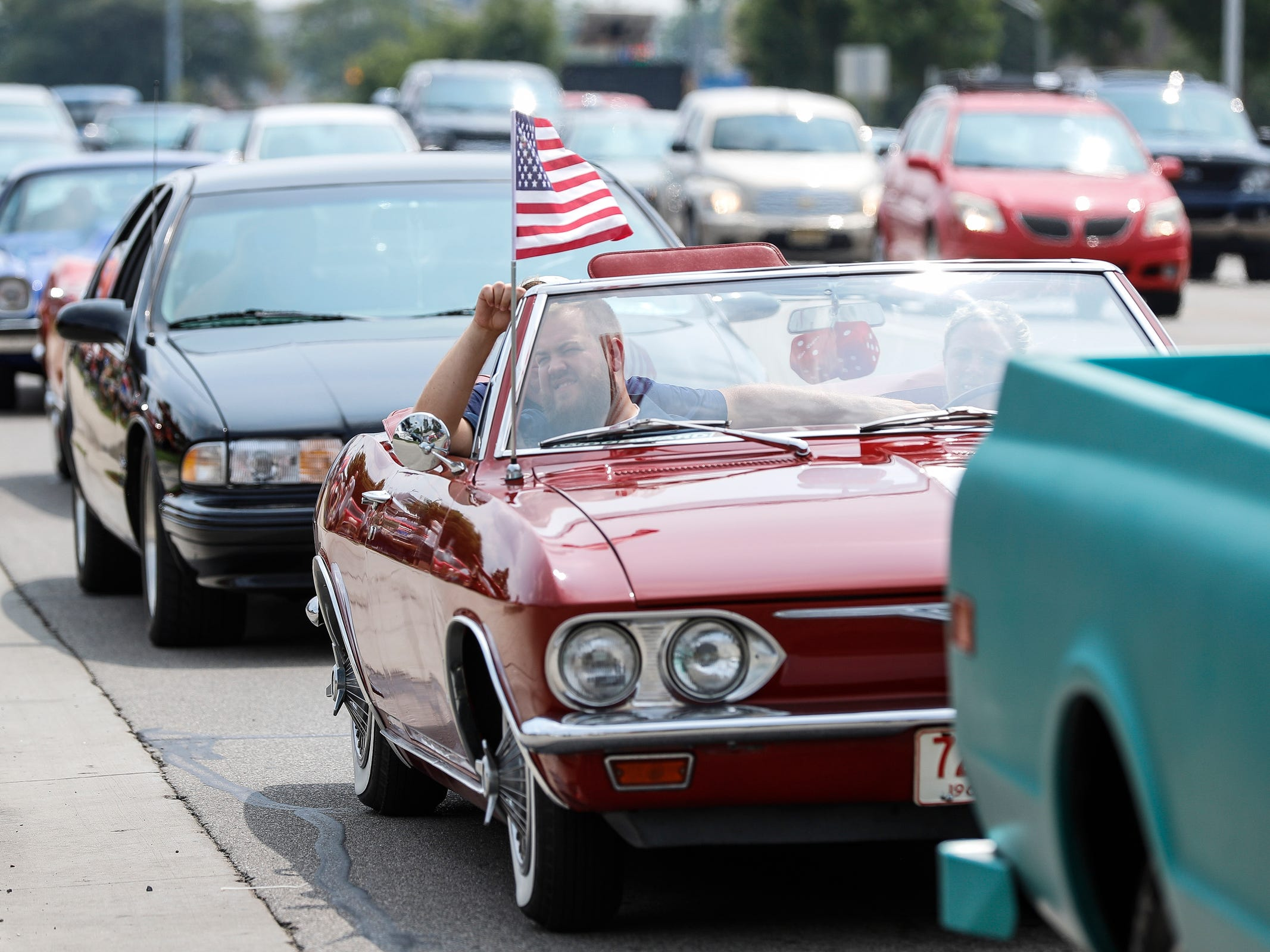 Classic and modern cars cruise along Woodward Avenue in Royal Oak during Woodward Dream Cruise, Saturday, Aug. 18, 2018.