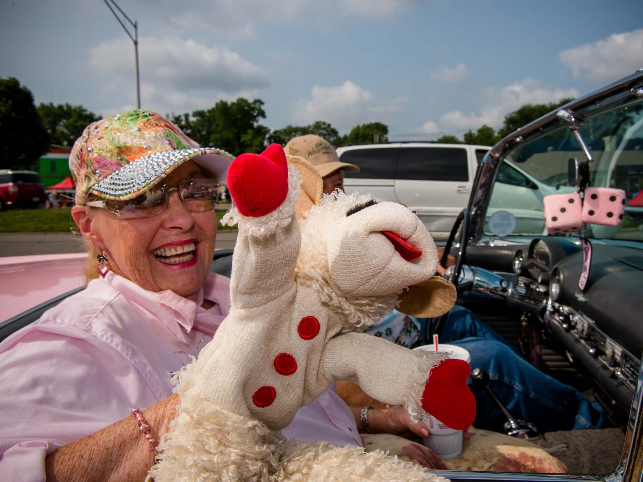 Pat Wiegand of Roseville rides in her pink Thunderbird with Lambchop during the 2018 Woodward Dream Cruise, Aug.. 18, 2018.