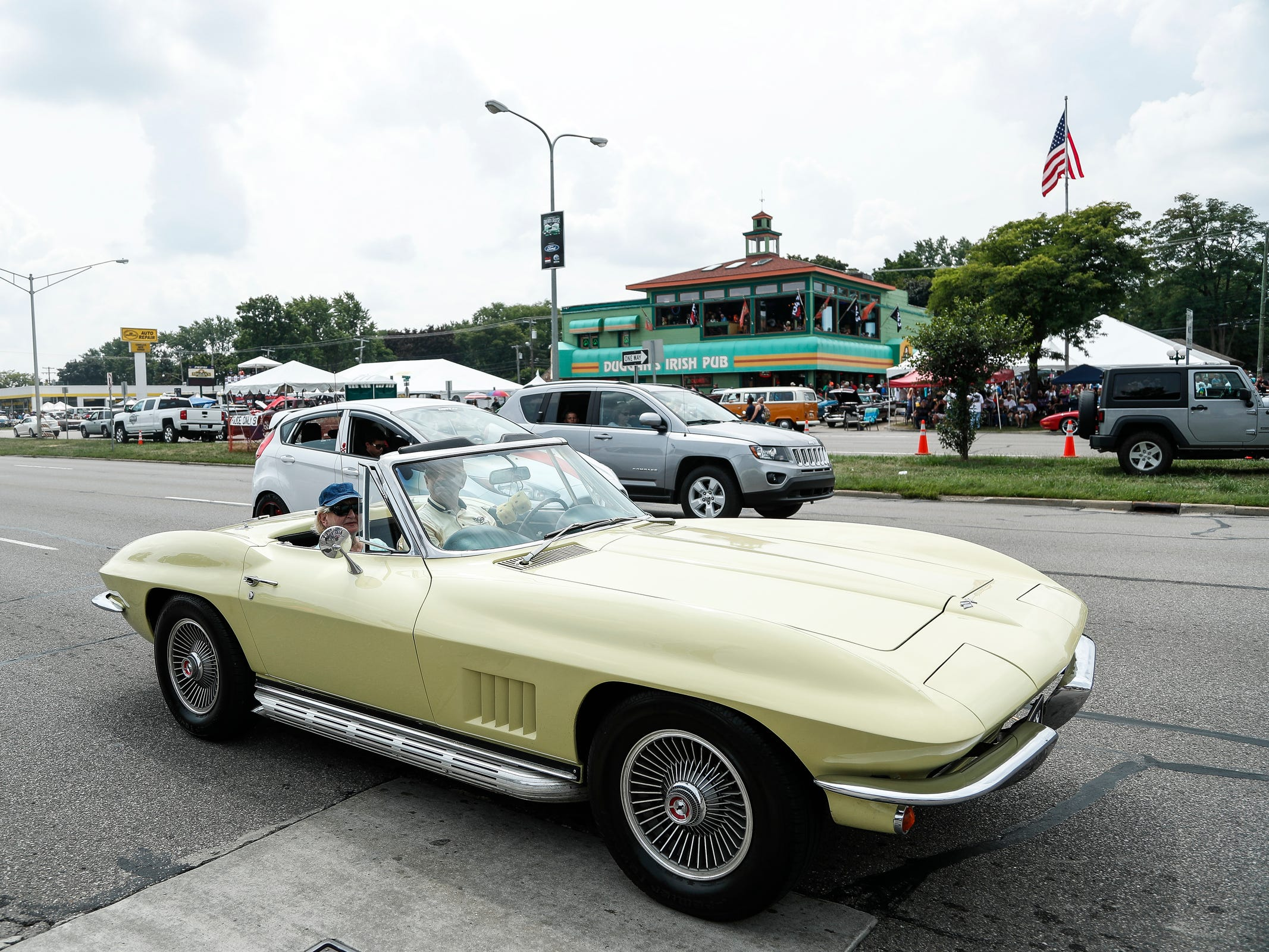 Classic and modern cars cruise along Woodward Avenue in Royal Oak during Woodward Dream Cruise, Saturday, August 18, 2018.