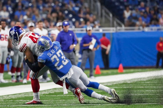 Lions defensive back Darius Slay (23) tackles New York Giants tight end Shane Smith (43) during the first half of the preseason game against Giants at Ford Field in Detroit, Friday, August 17, 2018.