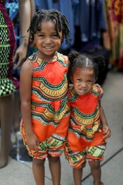 Deonna, 4, and Demara Hamilton, 2  both of Detroit, wear matching African garbs during the 36th Annual African World Festival at the Charles H. Wright of African-American History in Detroit on Saturday, Aug. 18, 2018.