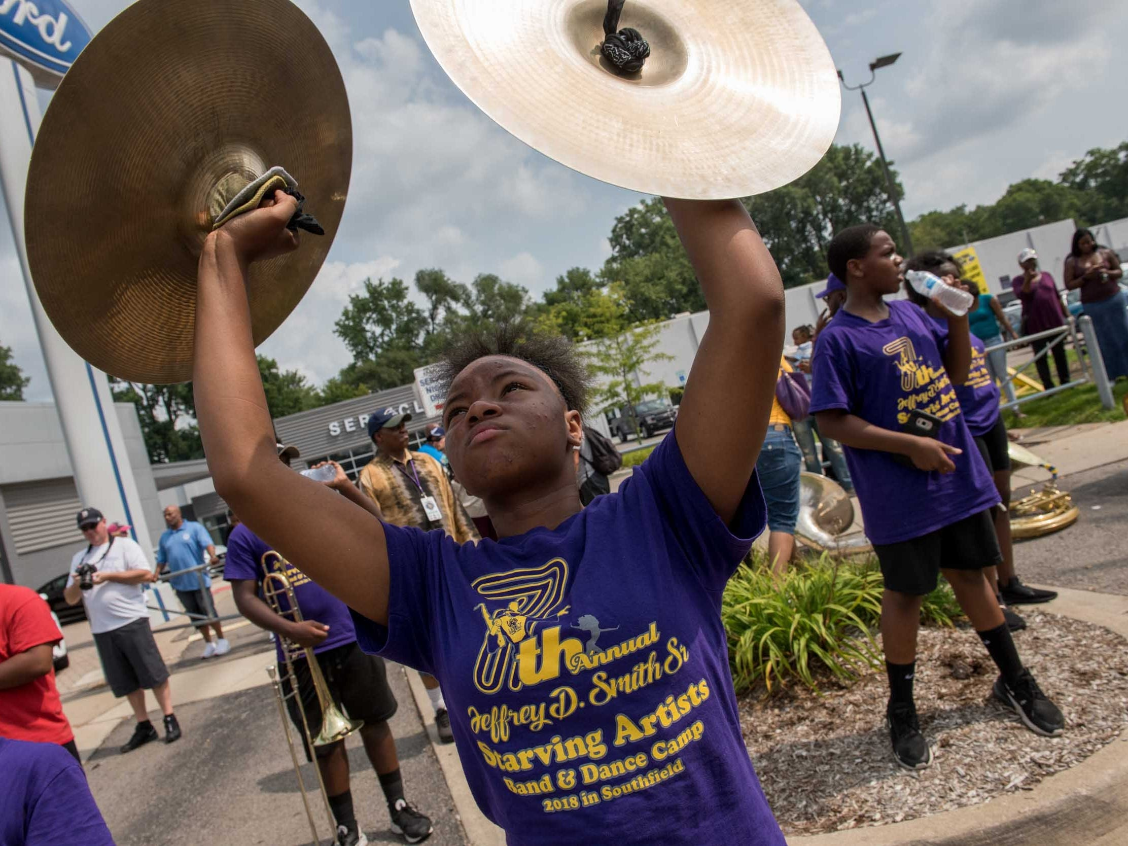 Students from Levey Middle school perform for cruisers during the Woodward Dream Cruise, Aug. 18, 2018.