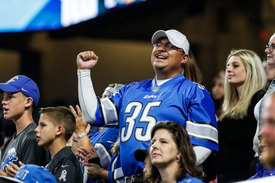 Detroit Lions fans celebrate a touchdown during the second half of the preseason game against New York Giants at Ford Field in Detroit, Friday, August 17, 2018.