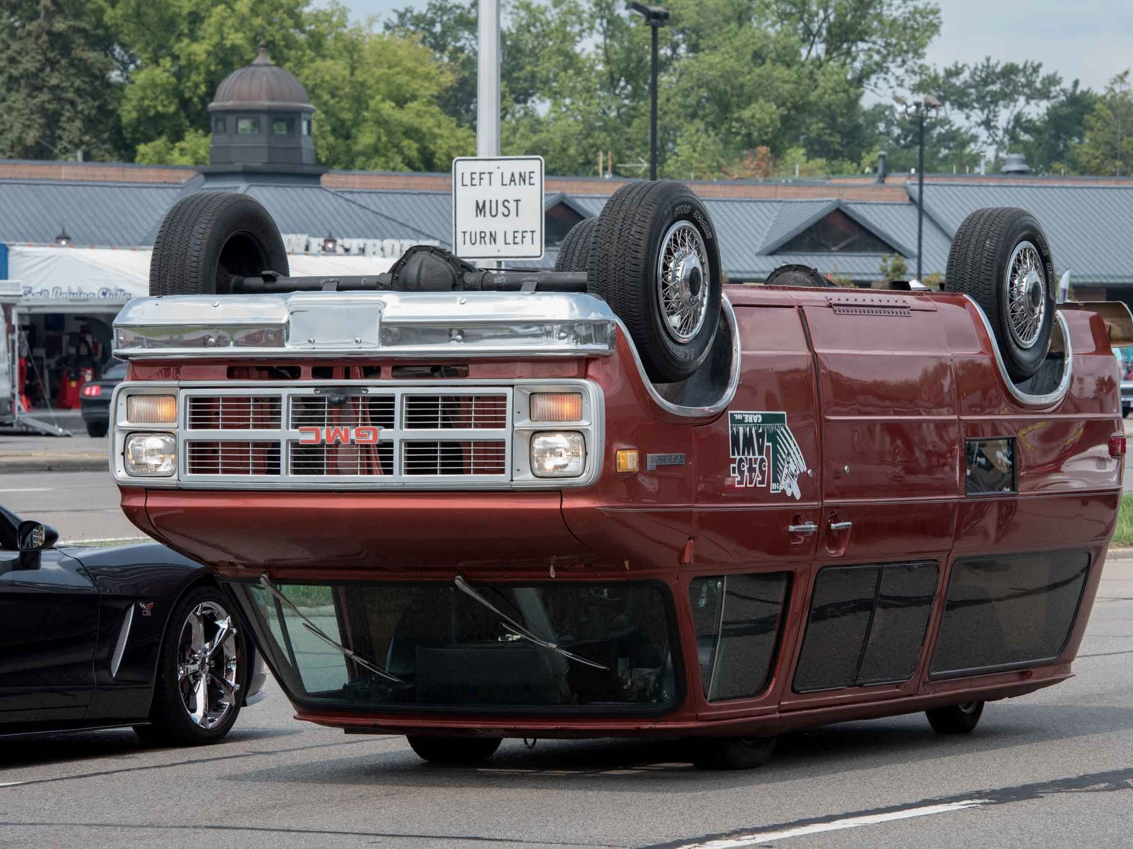 An upside down GMC vehicle is seen during the 2018 Woodward Dream Cruise on Aug. 18, 2018.