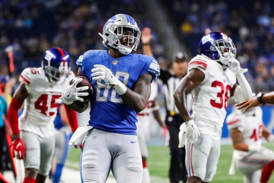 Detroit Lions tight end Michael Roberts (80) runs off the field after getting a first down during the second half of the preseason game against New York Giants at Ford Field in Detroit, Friday, August 17, 2018.