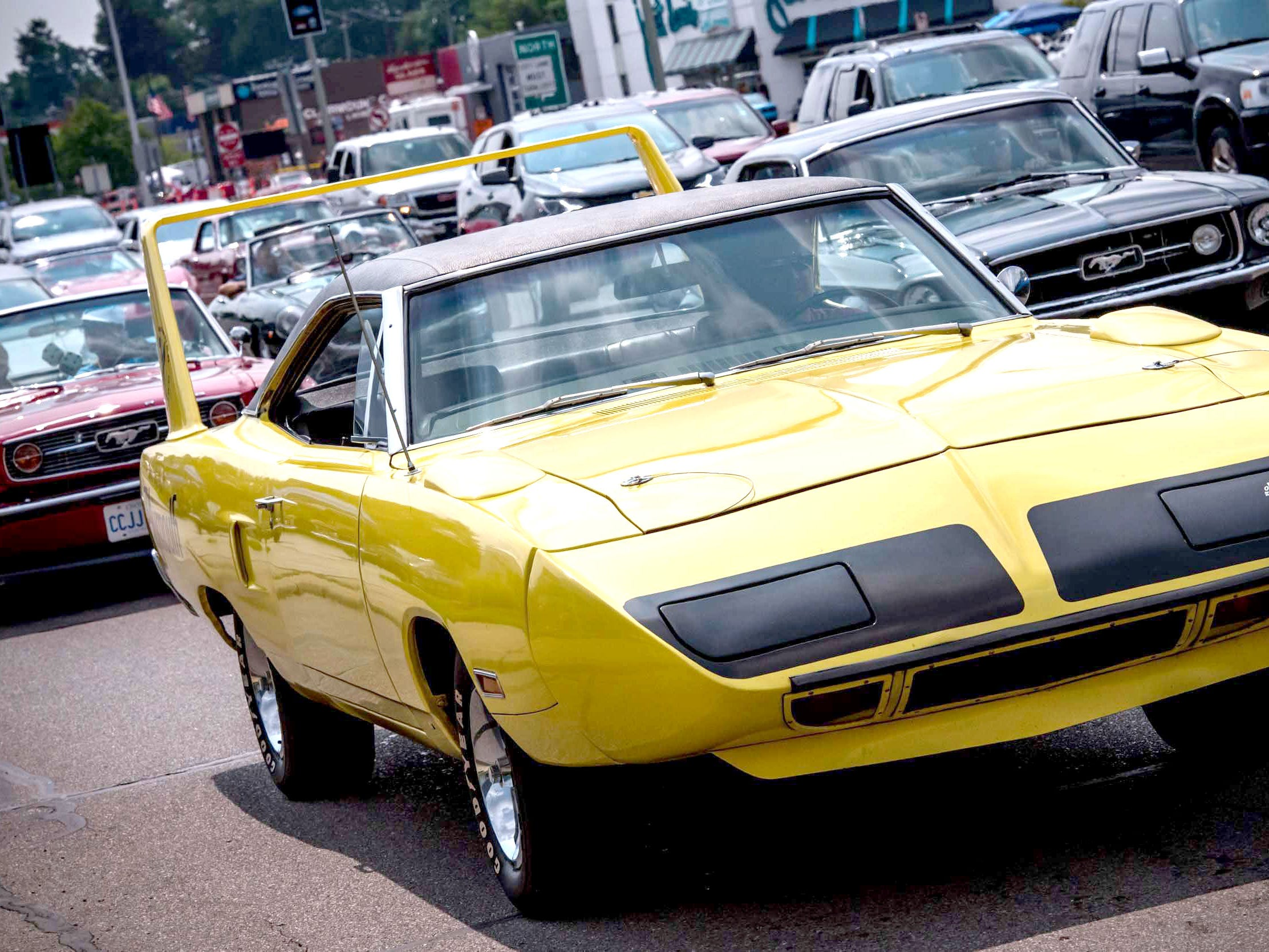 A 1970s Plymouth Superbee followed by classic Mustangs during the Woodward Dream Cruise August 18, 2018.