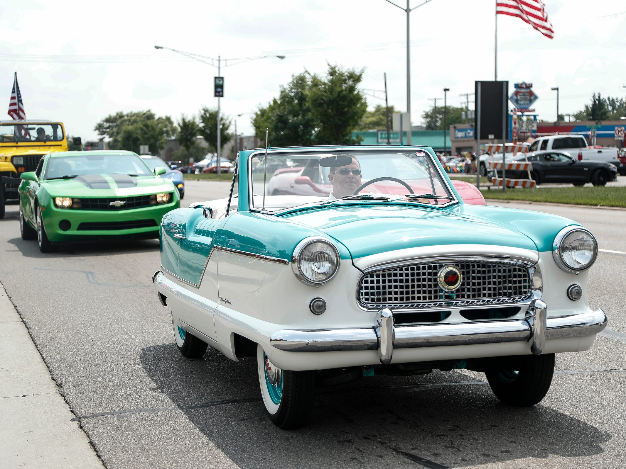 Classic and modern cars cruise along Woodward Avenue in Royal Oak during Woodward Dream Cruise, Saturday, Aug, 18, 2018.