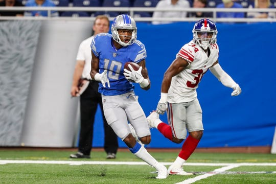 Detroit Lions wide receiver Teo Redding (10) runs against the New York Giants defensive back Grant Haley (34) during the second half of the preseason game against New York Giants at Ford Field in Detroit, Friday, August 17, 2018.