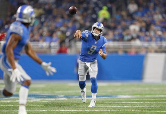 Detroit Lions quarterback Matthew Stafford (9) passes the ball during the first quarter against the New York Giants at Ford Field.