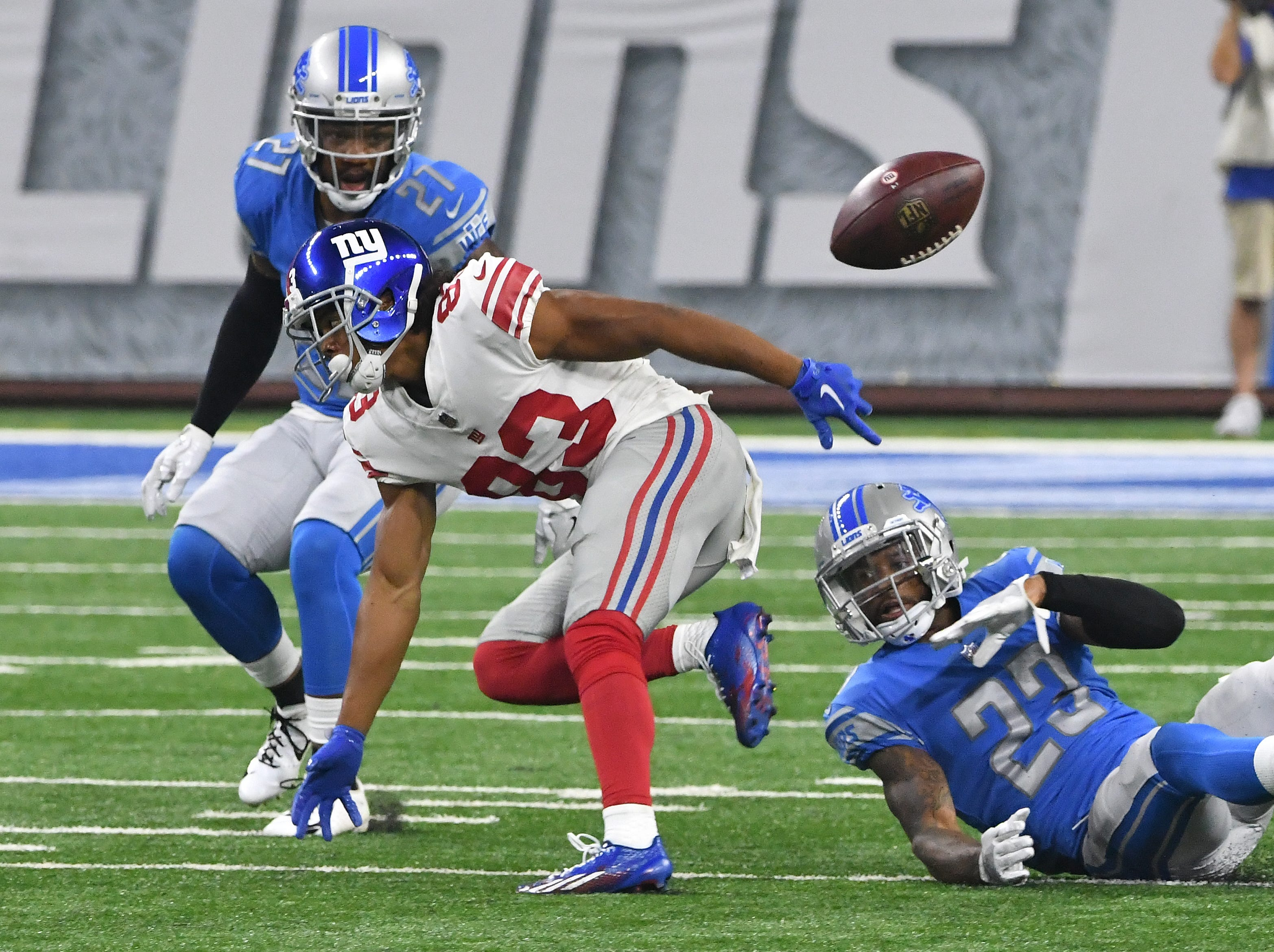 Lions' Darius Slay breaks up a 4th-and-1 pass intended for Giants' Kalif Raymond, turning the ball over to Detroit, in the second quarter.