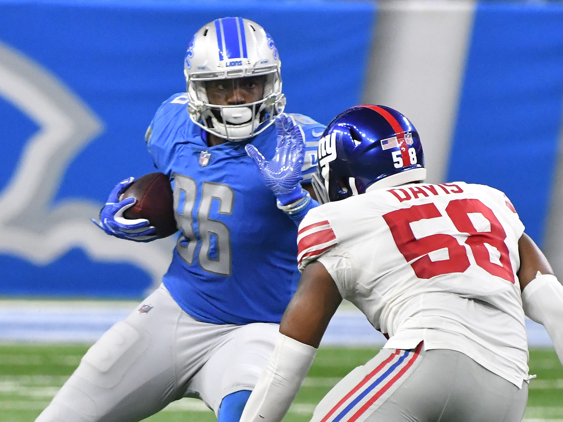Lions tight end Marcus Lucas works against Giants' Tae Davis in the fourth quarter.