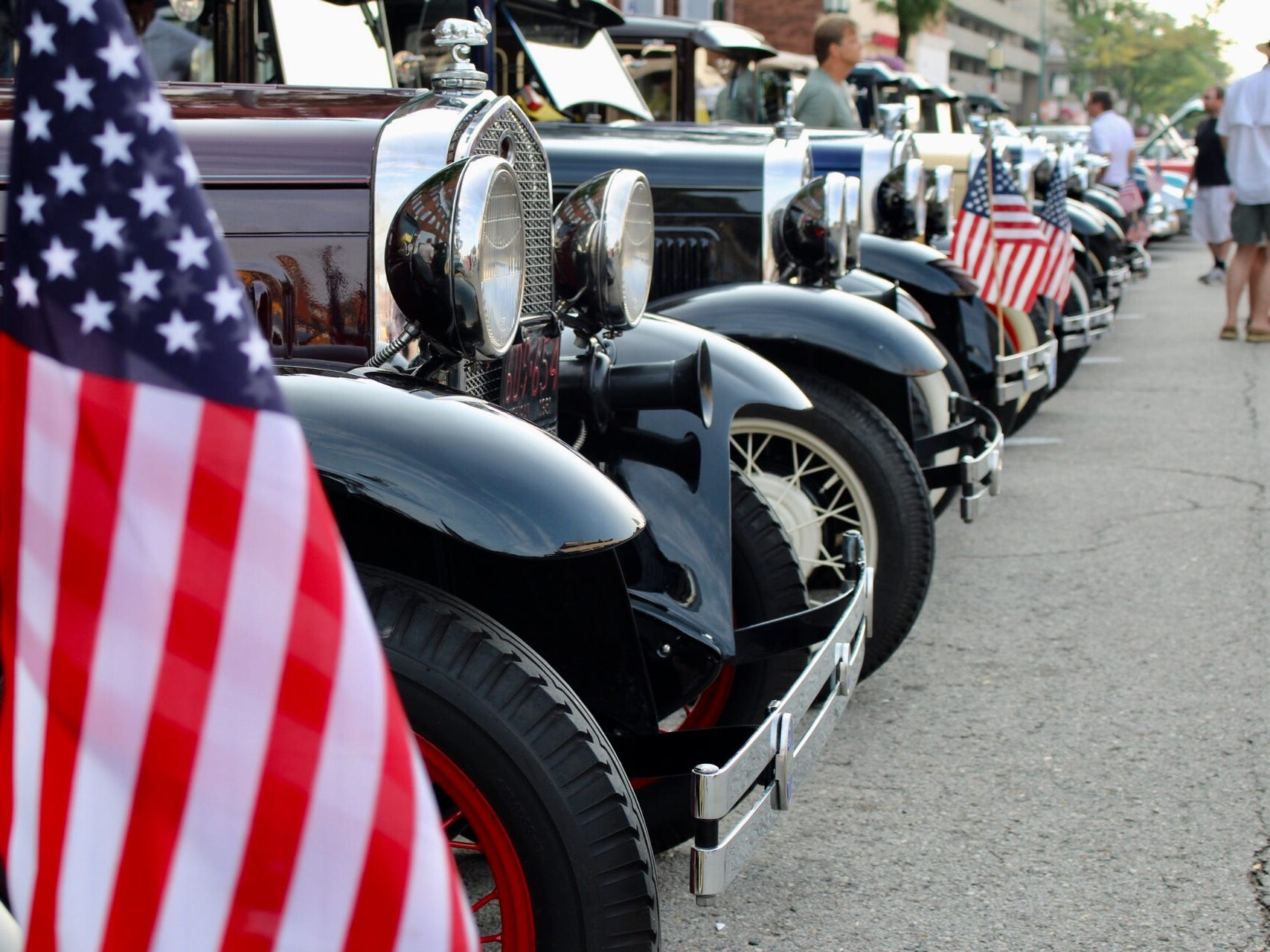 A patriotic lineup of Ford Model As is seen at the classic car show in Birmingham.
