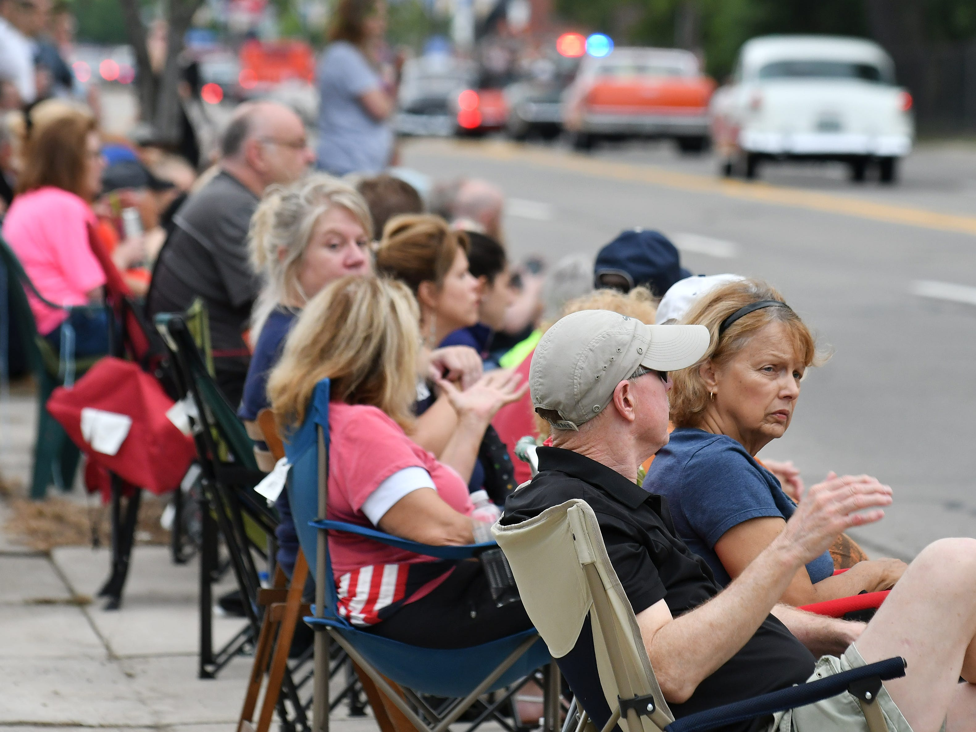 At end, Tom and Sue Zellman of Napoleon watch the Berkley CruiseFest Classic Car Parade.