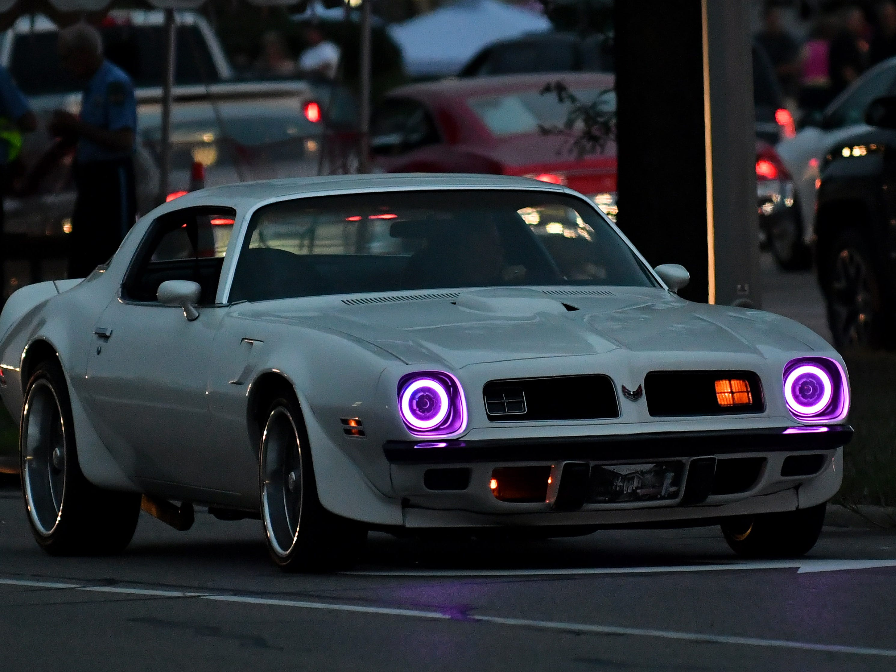 A bright-eyed Trans Am looks down Woodward.