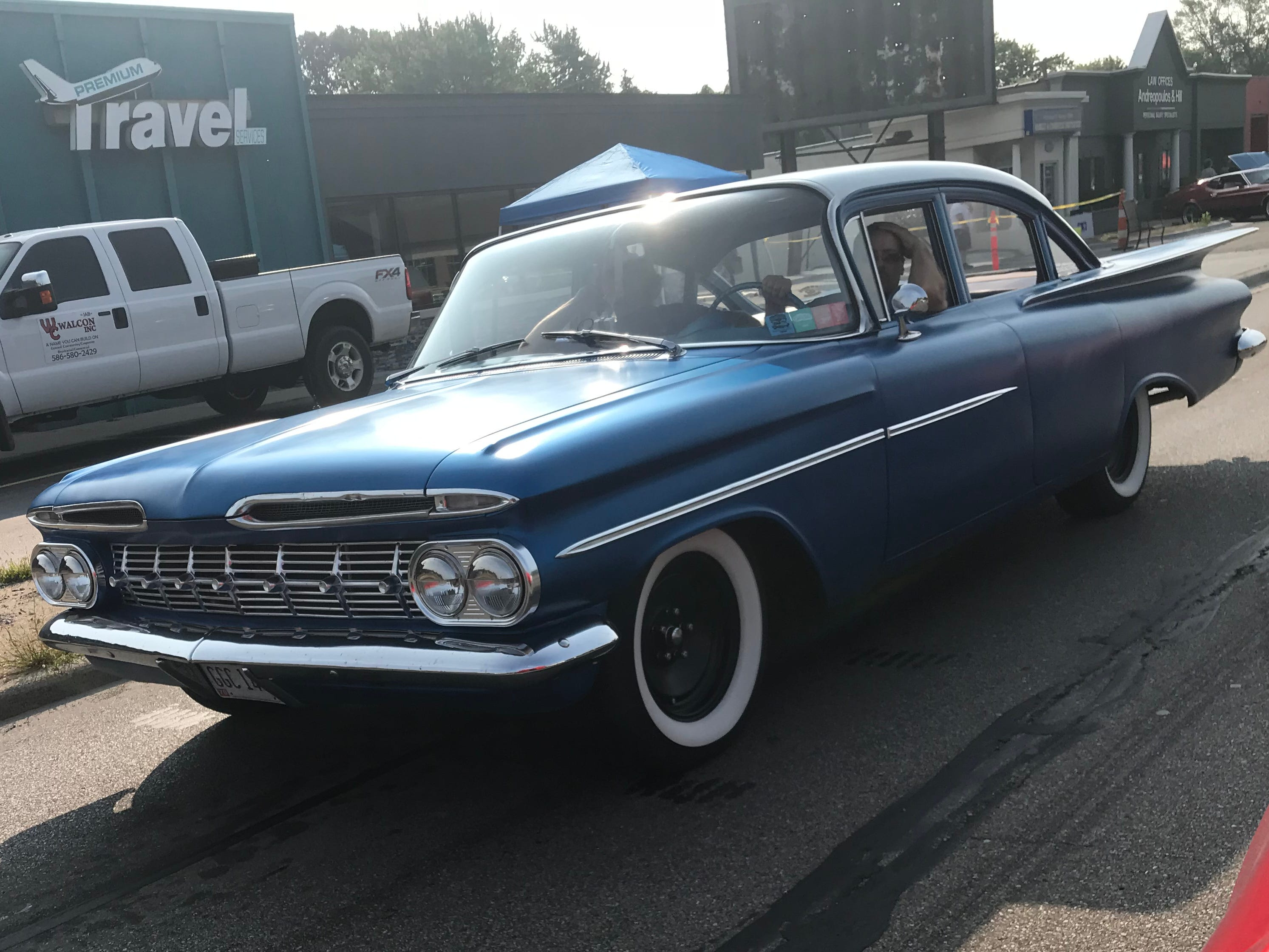 A 1950s blue Chevy Impala cruises down Woodward through Royal Oak.