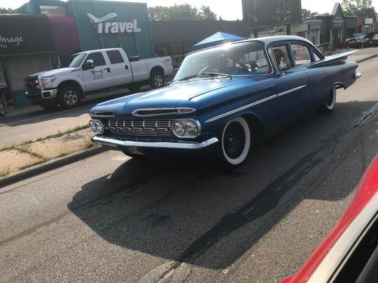 A 1950s blue Chevy Impala cruises down Woodward through Royal Oak.