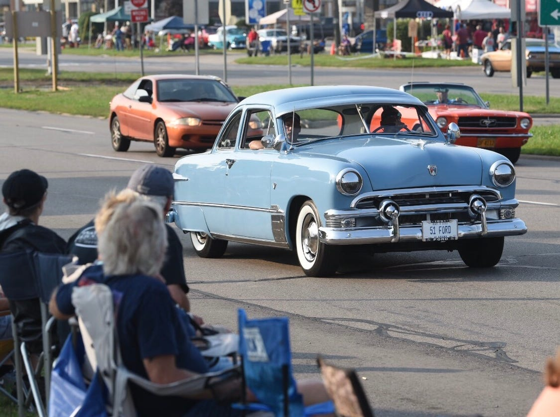 A 1951 Ford heads northbound on Woodward Avenue at 13 Mile Road for the Woodward Dream Cruise Saturday.