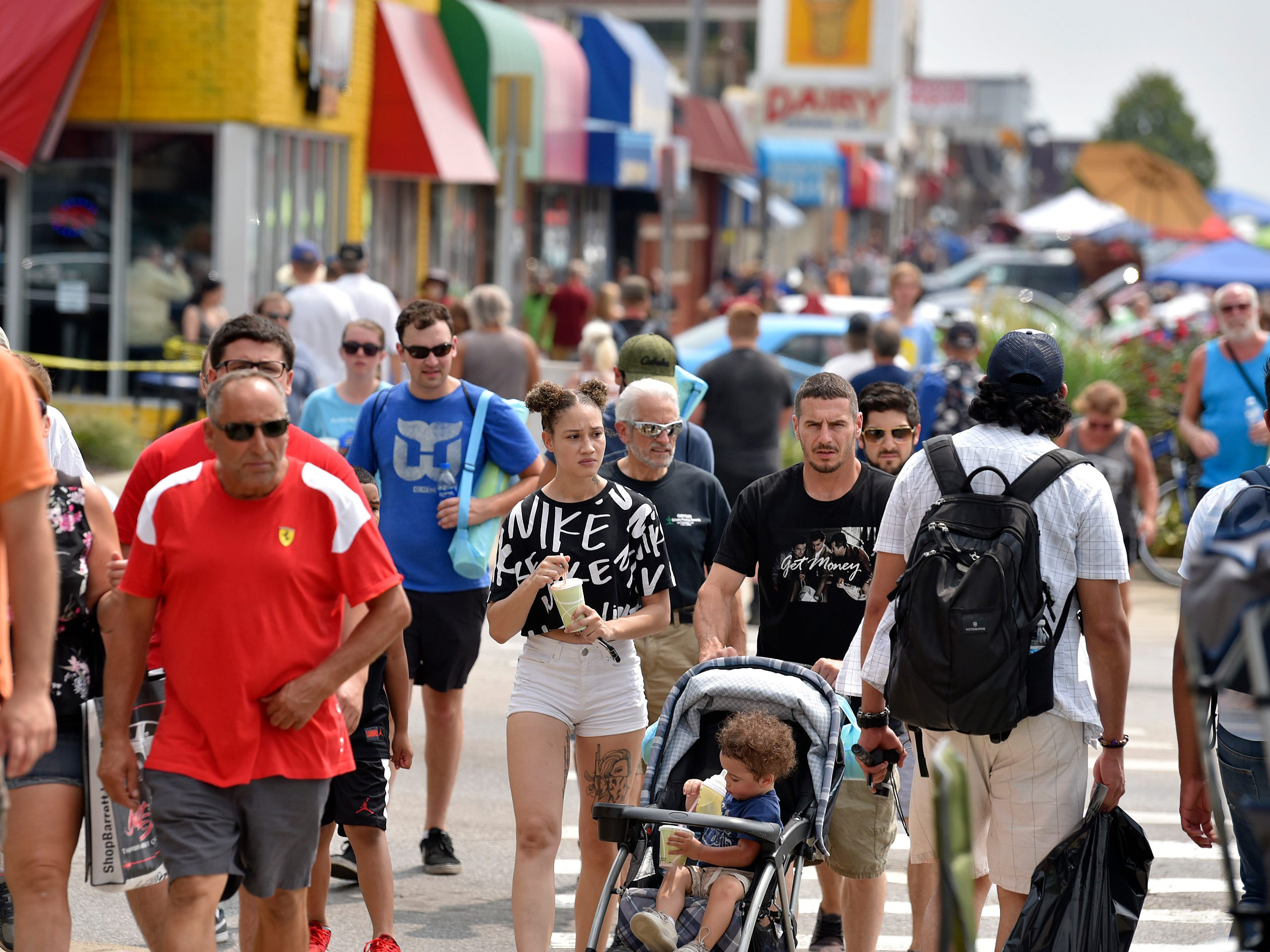Throngs of people attend the Woodward Dream Cruise in Royal Oak, Saturday, August 18, 2018.