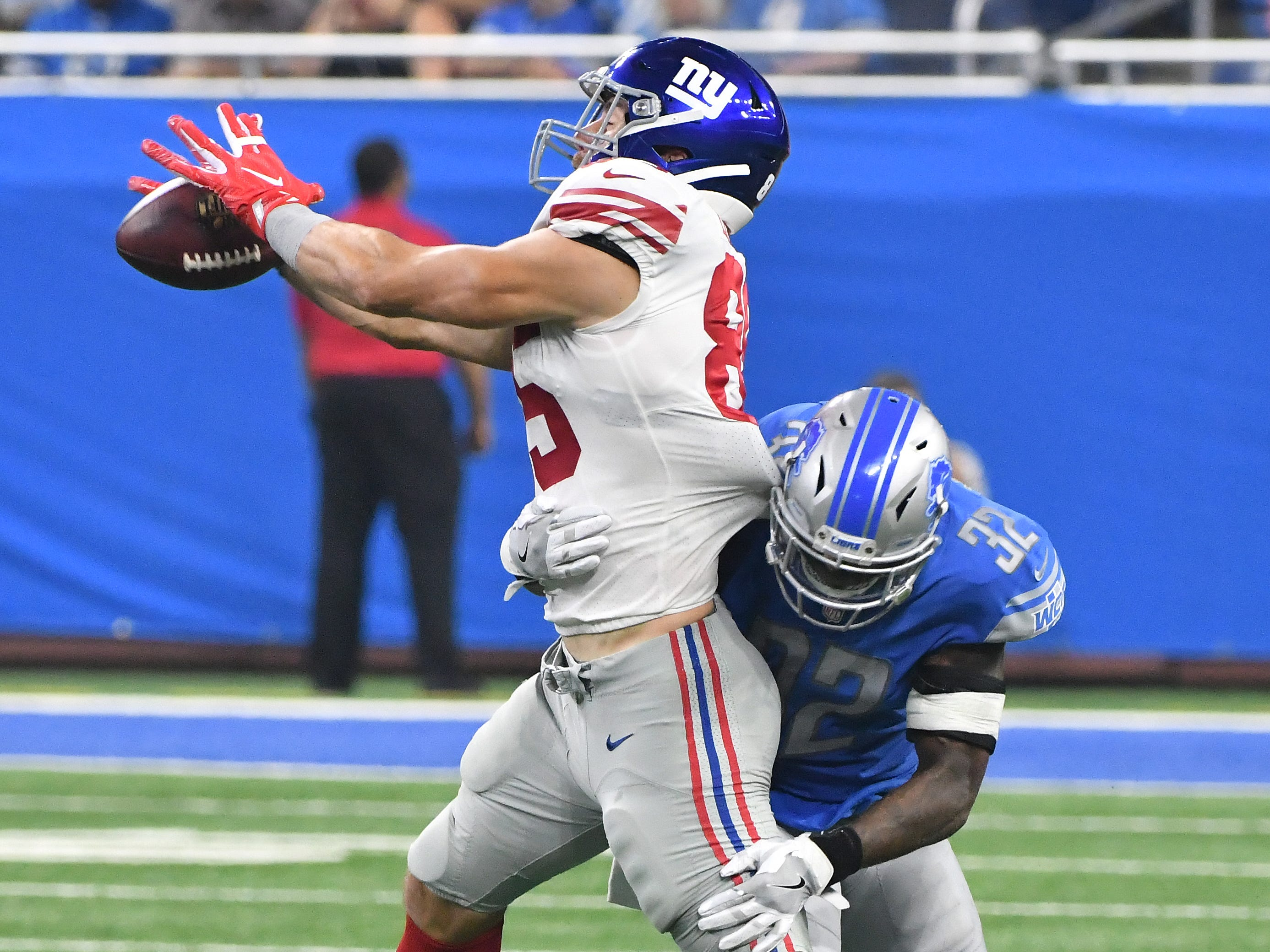 Lions' Tavon Wilson slams into Giants' Rhett Ellison forcing an incompletion in the second quarter.