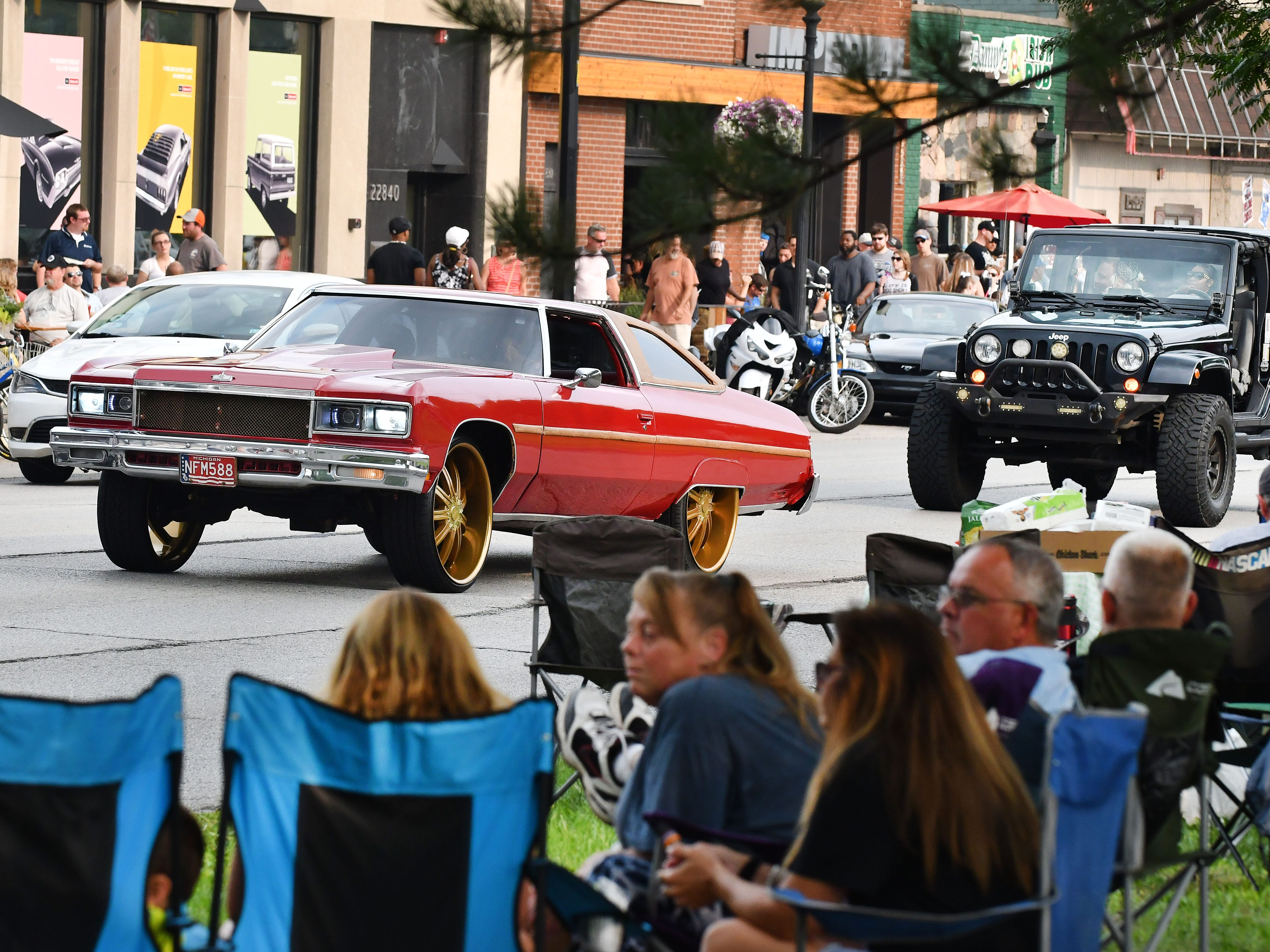 Unique and classic cars make their way down Woodward Avenue in Ferndale.