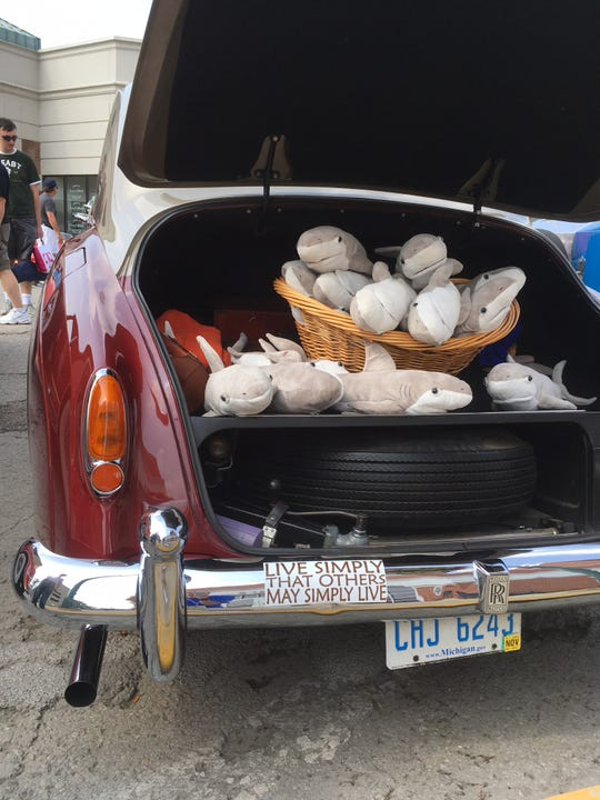 Peter Kohnken's '57 Rolls Royce has a basket of stuffed sharks in the boot and a satchel of realistic play money on the passenger seat.